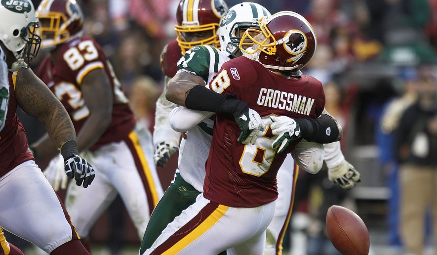 Washington Redskins quarterback Rex Grossman is sacked by New York Jets defensive end Aaron Maybin forcing a fumble during the second half in Landover, Md., Sunday, Dec. 4, 2011. (AP Photo/Evan Vucci)
