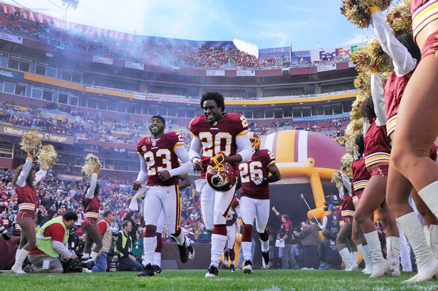 Washington Redskins cornerback DeAngelo Hall (23) and free safety Oshiomogho Atogwe (20) run on the field before the start of the game at FedEx Field in Landover, Md., on Sunday, December 4, 2011. (Preston Keres/For The Washington Times)