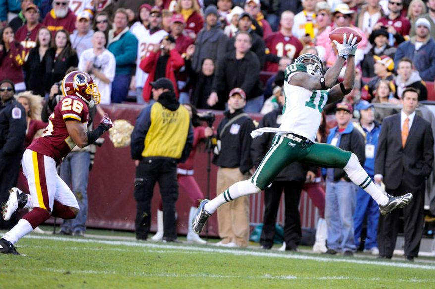 New York Jets wide receiver Santonio Holmes (10) catches a go-ahead touchdown in front of Washington Redskins cornerback Josh Wilson (26) in the fourth quarter. (Preston Keres/For The Washington Times)