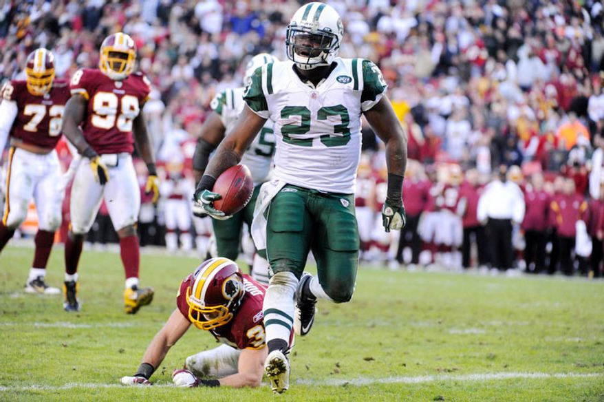 New York Jets running back Shonn Greene (23) scores in the fourth quarter in front of Washington Redskins free safety Reed Doughty (37) to give his team a 27-16 lead. (Preston Keres/For The Washington Times)