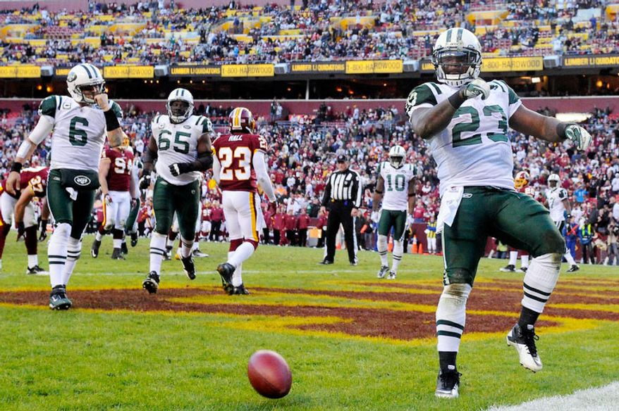 New York Jets running back Shonn Greene (23) celebrates his fourth quarter touchdown that put the Jets up 27-16 in the fourth. (Preston Keres/For The Washington Times)