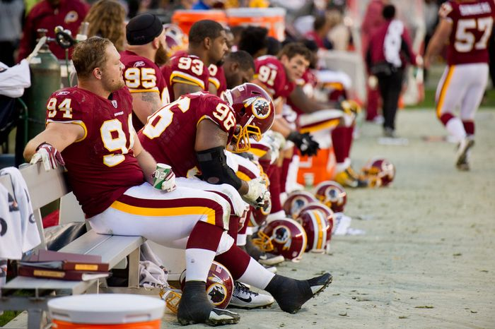 Washington Redskins defensive end Adam Carriker (94) and Washington Redskins nose tackle Barry Cofield (96) sit dejected on the bench as the game gets away from the Redskins in the fourth quarter. (Andrew Harnik/The Washington Times)