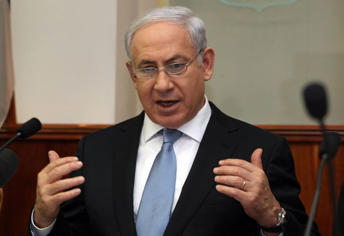 Israeli Prime Minister Benjamin Netanyahu attends the weekly Cabinet meeting in Jerusalem on Sunday, Dec. 4, 2011. (AP Photo/Gali Tibbon, Pool)