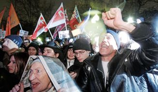 """Supporters of Russian opposition parties chant anti-goverment slogans during a rally in Moscow on Monday. It was thought to be the largest opposition rally in years and ended with police detaining some of the activists. They chanted """"Russia without Putin."""" (Associated Press)"""