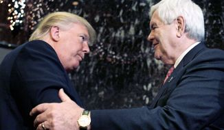Newt Gingrich and Donald Trump shake hands after speaking to reporters in New York on Monday. Mr. Gingrich praised Mr. Trump after Rep. Ron Paul earlier criticized him and declined an invitation to a debate he will host in Iowa on Dec. 27. (Associated Press)