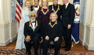 Secretary of State Hillary Rodham Clinton (left) and former President Bill Clinton (right) pose with 2011 Kennedy Center Honorees (front row from left) Sonny Rollins, Barbara Cook, (back row from second from left) Yo-Yo Ma, Meryl Streep and Neil Diamond at the State Department following a dinner and reception on Saturday, Dec. 3, 2011, in Washington. (AP Photo/Kevin Wolf)