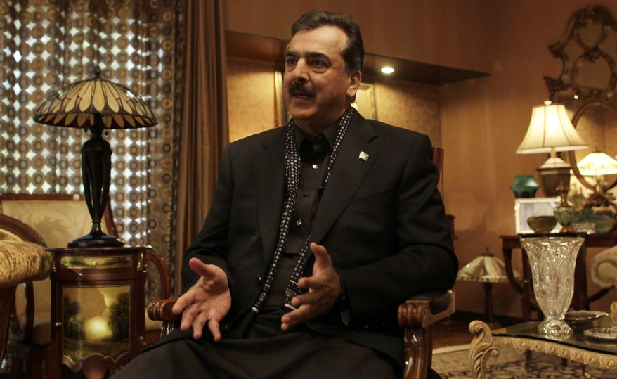 ** FILE ** Pakistani Prime Minister Yousuf Raza Gilani gives an interview at his home on Monday, Dec. 5, 2011. (AP Photo/Muhammed Muheisen)