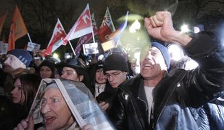 Russian opposition members chant anti-government slogans during a rally in Moscow on Monday, Dec. 5, 2011, to protest against Prime Minister Vladimir Putin and his party. (AP Photo/Ivan Sekretarev)