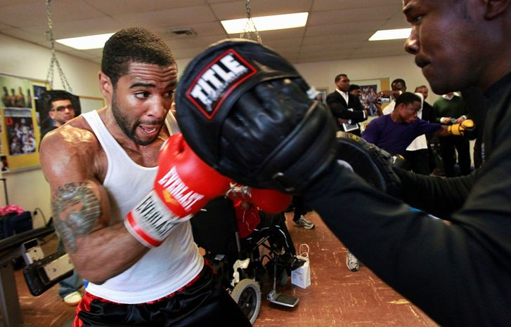 D.C. native Lamont Peterson, working on hand drills, will fight in a super lightweight title bout on the same card as Seth Mitchell's heavyweight bout Dec. 10. (Associated Press)