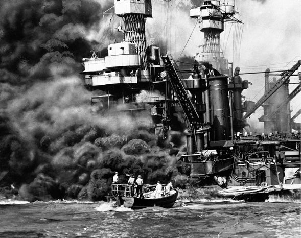 """FILE - In this Dec. 7, 1941 file photo provided by the U.S. Navy, a Navy launch pulls up to the blazing USS West Virginia to rescue a sailor during the attack on Pearl Harbor. An excavation crew recently made a startling discovery at the bottom of Pearl Harbor when it unearthed a skull that archeologists suspect is from a Japanese pilot who died in the historic attack. Archaeologist Jeff Fong of the Naval Facilities Engineering Command Pacific described the discovery to The Associated Press and the efforts under way to identify the skull. He said the early analysis has made him """"75 percent sure"""" that the skull belongs to a Japanese pilot. (AP Photo/U.S. Navy, file)"""
