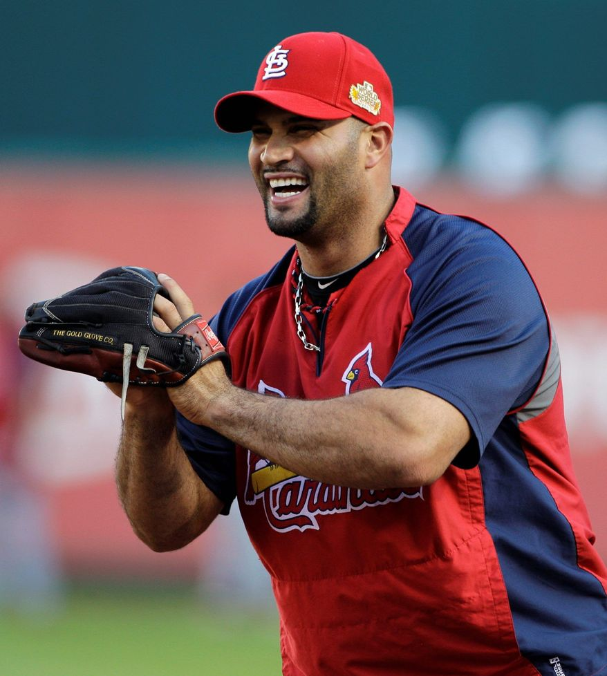 The free-spending Miami Marlins reportedly are going after Albert Pujols, the biggest fish in the free agent market. (Associated Press)