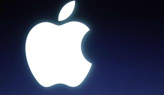 ** FILE ** In this Tuesday, Oct. 4, 2011, file photo and Apple logo is seen during an announcement at Apple headquarters in Cupertino, Calif.  (AP Photo/Paul Sakuma, file)