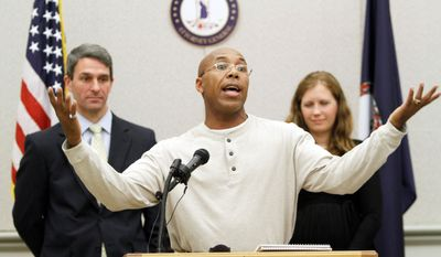 Thomas Haynesworth, who spent 27 years behind bars, center, gestures during a press conference with Virginia Attorney General Kenneth Cuccinelli II, left, and Shawn Armbrust, of the Mid Atlantic Innocence Project, right, in Richmond, Va., Tuesday, Dec. 6, 2011. Haynesworth was exonerated of two 1984 sexual assault convictions. (AP Photo/Steve Helber)