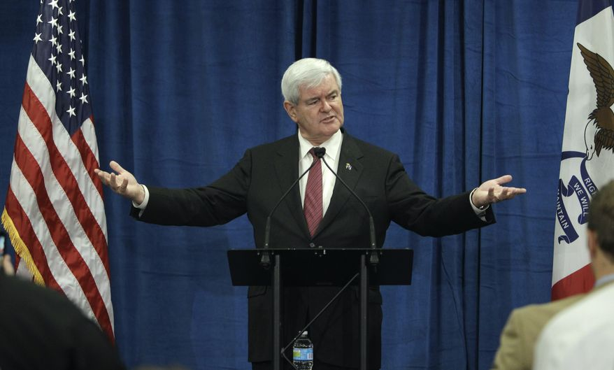 ** FILE ** In this Dec. 1, 2011, file photo, Republican presidential candidate, former House Speaker Newt Gingrich speaks during a meeting with employees at Nationwide Insurance in Des Moines, Iowa. (AP Photo/Charlie Neibergall, File)