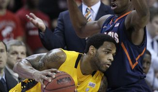 Maryland guard Sean Mosley, left, tries to drive past Illinois guard Brandon Paul as Illinois coach Bruce Weber, background, looks on in the first half of an NCAA basketball game in College Park, Md., Tuesday, Nov. 29, 2011. (AP Photo/Patrick Semansky)