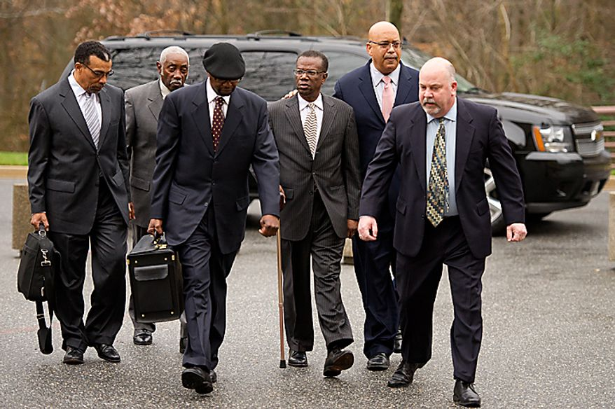 Former Prince George's County Executive Jack Johnson (third from right) walks into the U.S. District Courthouse in Greenbelt on Tuesday, Dec. 6, 2011, for his sentencing after being found guilty of corruption in a pay-to-play scandal. Billy Martin, his lawyer, is at left. (Andrew Harnik/The Washington Times)