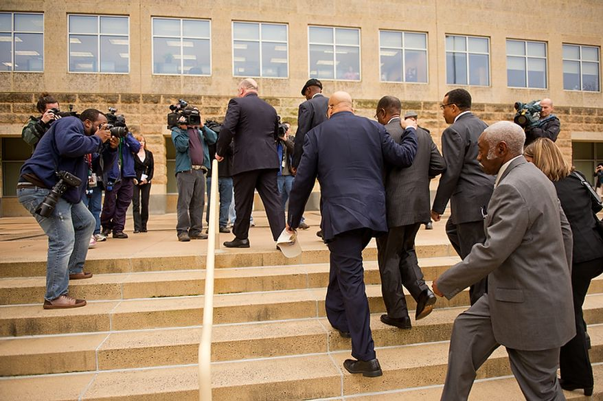 Former Prince George's County Executive Jack Johnson walks into the U.S. District Courthouse in Greenbelt, Md., on Dec. 6, 2011, for his sentencing after being found guilty for corruption in a pay-to-play scandal. (Andrew Harnik/The Washington Times)