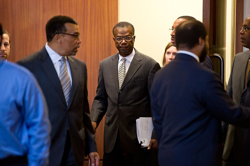 Former Prince George's County Executive Jack Johnson and his lawyer Billy Martin, left, walk out of the U.S. District Courthouse in Greenbelt after Johnson was sentenced to seven years and three months in Greenbelt, Md., Tuesday, Dec. 6, 2011. (Andrew Harnik/The Washington Times)