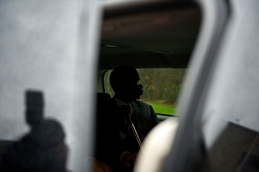 Former Prince George's County Executive Jack Johnson sits in his SUV outside the U.S. District Courthouse in Greenbelt after being sentenced to seven years and three months after being found guilty for corruption in a pay-to-play scandal, Greenbelt, Md., Tuesday, Dec. 6, 2011. (Andrew Harnik/The Washington Times)