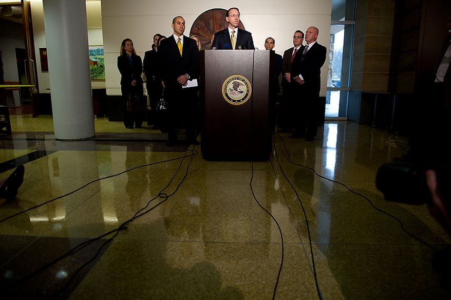 U.S. Attorney for Maryland Rod Rosensten speaks to reporters after former Prince George's County Executive Jack Johnson is given seven years and three months for corruption in a pay-to-play scandal, at the U.S. Courthouse in Greenbelt, Greenbelt, Md., Tuesday, Dec. 6, 2011. (Andrew Harnik/The Washington Times)