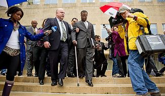 Former Prince George's County Executive Jack Johnson walks out of the U.S. District Courthouse in Greenbelt with his lawyer Jeff Harding, left, after being sentenced to seven years and three months after being found guilty for corruption in a pay-to-play scandal, Greenbelt, Md., Tuesday, Dec. 6, 2011. (Andrew Harnik/The Washington Times)