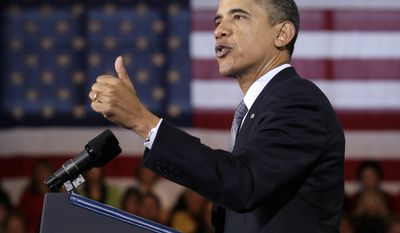President Obama gestures while speaking about the economy on Tuesday, Dec. 6, 2011, at Osawatomie High School in Osawatomie, Kan. (AP Photo/Carolyn Kaster)