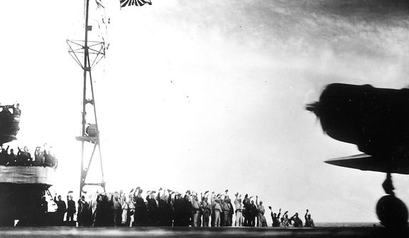"This photograph, from a Japanese film later captured by American forces, is taken aboard the Japanese aircraft carrier Zuikaku, just as a Nakajima ""Kate"" B-5N bomber is launching off deck for the second wave of the attack on Pearl Harbor, Hawaii, on December 7, 1941. (AP Photo)"