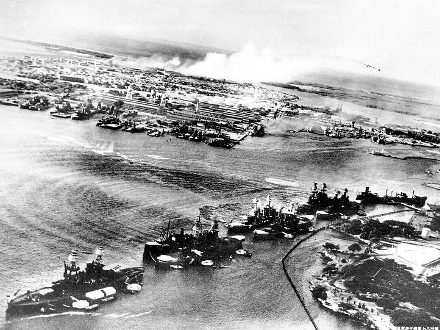 This picture, taken by a Japanese photographer, shows how American ships are clustered before the surprise Japanese aerial attack on Pear Harbor, Hawaii, on Sunday morning, Dec. 7, 1941. Minutes later, the full impact of the assault was felt, and Pearl Harbor became a flaming target. (AP Photo)