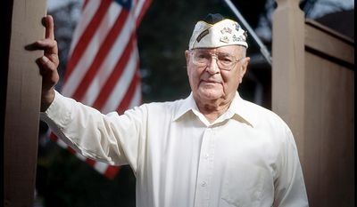 """Jay Groff, 89, served in the Army Air Corps Rescue Boat Service at Pearl Harbor, Oahu. Groff was in bed as the Japanese attack on Pearl Harbor began, which he says probably saved his life. Groff calls the attack the most important day of the 20th century, adding that """"the world changed for the United States."""" He goes on to say, """"I grew up overnight.... That morning, I realized that there was somebody out there trying to kill me. That changed my outlook on life."""" Groff is seen at his home in Springfield, Va. on Nov. 21, 2011. (T.J. Kirkpatrick/ The Washington Times)"""