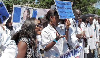 Hundreds of doctors from public medical facilities march through Nairobi on Wednesday. The starting wage for doctors in Kenya is about $400 a month. In contrast, members of parliament make about $11,000 a month. (Associated Press)