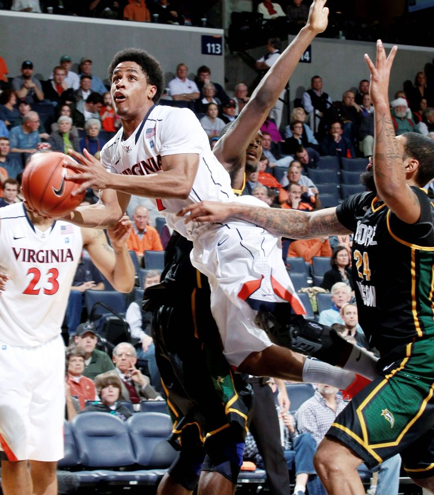 Virginia guard Jontel Evans didn't alllow a bad first half to ruin his night in Tuesday's 68-48 victory over George Mason. (Associated Press)