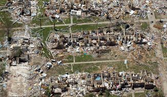 Tornado damage is seen from a bird's-eye view in Tuscaloosa, Ala., on May 7. America's wild weather year hit a new high: a devastating dozen billion-dollar disasters.