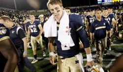 Quarterback Kriss Proctor and his Navy teammates lost five games this season by a combined 11 points. The Midshipmen will look to beat Army for the 10th consecutive time when the service academies meet Saturday at FedEx Field. (Associated Press)