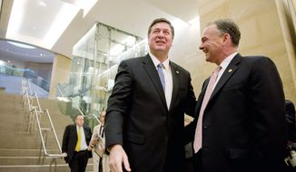 """CALM BEFORE THE STORM: Tim Kaine (right) and George Allen greet each other in the hallway before beginning the first debate of the 2012 Senate campaign at the Virginia State Capitol in Richmond on Wednesday. Both of the Senate candidates are former Virginia governors. Issues at the 90-minute debate included """"personhood"""" and budgets. (Andrew Harnik/The Washington Times)"""