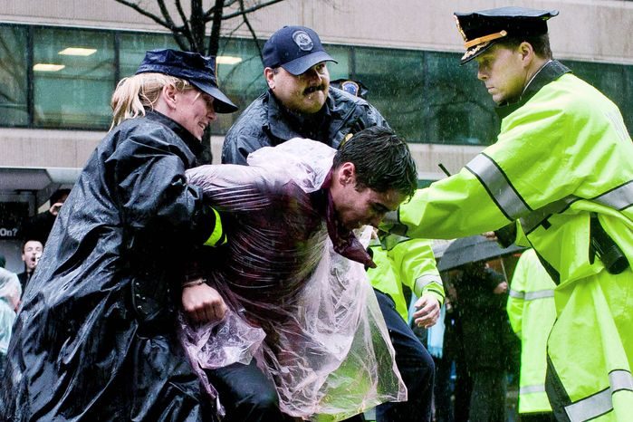 Occupy DC protesters are arrested as they block the intersection of 14th St. NW and K St. NW in Washington, D.C. on December 7, 2011. (T.J. Kirkpatrick/ The Washington Times)