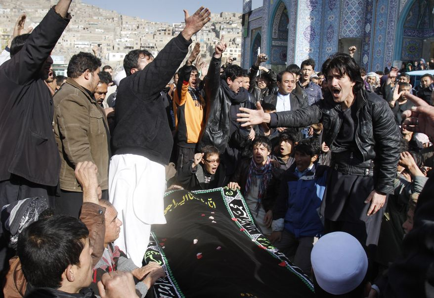 Afghans shout slogans during a funeral for a victim of Tuesday's suicide attack in Kabul, Afghanistan, on Wednesday, Dec. 7, 2011. (AP Photo/Ahmad Jamshid)