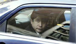 Former Illinois Gov. Rod Blagojevich arrives by car with his wife, Patti, at the federal building in Chicago on Wednesday, Dec. 7, 2011, for his sentencing hearing on 18 corruption counts, including trying to auction off President Obama's old Senate seat. (AP Photo/Kiichiro Sato)