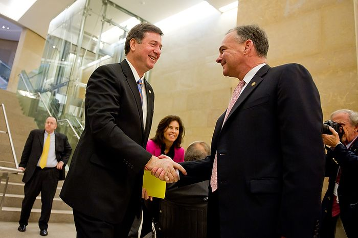Former Virginia governors and current U.S. Senate candidates Tim Kaine (D), right, and George Allen (R), left, greet each other in the hallway before beginning their first debate for the 2012 campaign held at the annual AP Day at the Virginia State Capitol, Richmond, VA, Wednesday, December 7, 2011. (Andrew Harnik / The Washington Times)
