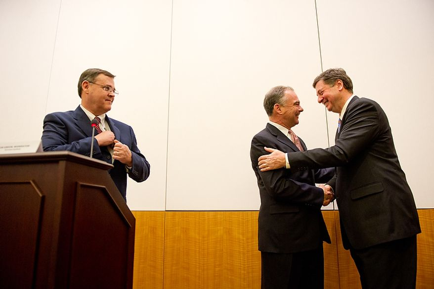Former Virginia governors and current U.S. Senate candidates Tim Kaine (D), center, and George Allen (R), right, shake hands following their first debate for the 2012 campaign held at the annual AP Day at the Virginia State Capitol, Richmond, VA, Wednesday, December 7, 2011. Also pictured is Moderator Bob Gibson, Director of the Sorensen Institute for Political Leadership. (Andrew Harnik / The Washington Times)
