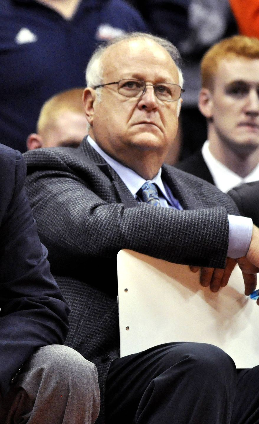 **FILE** Syracuse basketball assistant coach Bernie Fine watches a college basketball game against Manhattan in the NIT Season Tip-Off in Syracuse, N.Y., on Nov. 14, 2011. (Associated Press)