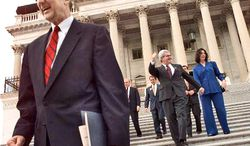 ** FILE ** Rep. Bob Livingston (left), followed by outgoing House Speaker Newt Gingrich and his wife, Marianne, walks down the steps of the Capitol in Washington on Wednesday, Nov. 18, 1998. The men were going to a meeting at which Republicans were to choose their leadership for the 106th Congress. (AP Photo/Pablo Martinez Monsivais, File)
