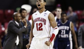 Maryland guard Terrell Stoglin reacts after making a basket in the second half against Mount St. Mary's in College Park, Md., on Wednesday, Dec. 7, 2011. Stoglin led all scorers with 23 points in Maryland's 77-74 win. (AP Photo/Patrick Semansky)