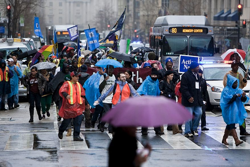A protest march organized by the Service Employees International Union winds through downtown on to I St. NW on the way to join an Occupy DC protest on K St. NW in Washington, D.C. on Dec. 7, 2011.