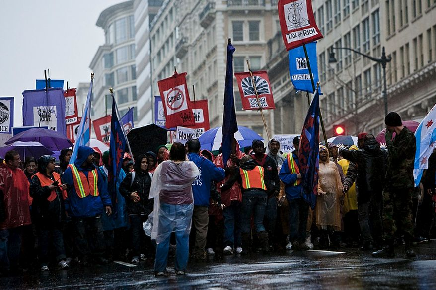 A protest march organized by the Service Employees International Union winds through downtown on 14th St. NW in Washington, D.C. on Dec. 7, 2011. (T.J. Kirkpatrick/ The Washington Times)