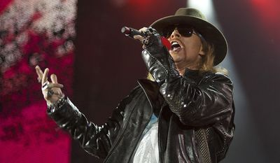 ** FILE ** Axl Rose, lead singer of the rock band Guns N' Roses, performs during a concert on Yas Island in Abu Dhabi, United Arab Emirates, in June 2010. (AP Photo/Nousha Salimi, File)