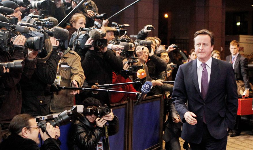 British Prime Minister David Cameron arrives for an EU summit in Brussels on Thursday. During a two-day summit, German Chancellor Angela Merkel and French President Nicolas Sarkozy will try to build support for their plan for eurozone nations to submit their national budgets to much greater scrutiny. (Associated Press)