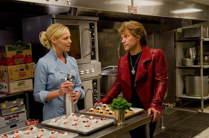 "Katherine Heigl plays a caterer recovering from a broken relationship with a pop star played by Jon Bon Jovi in ""New Year's Eve."" (Warner Bros. Pictures via Associated Press)"