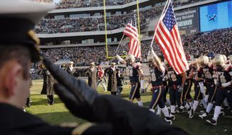 The Army-Navy game always is a star-spangled spectacle. Saturday's renewal of the rivalry marks the first time it will be played inside the Capital Beltway. (Rod Lamkey Jr./The Washington Times)