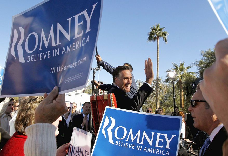 Former Massachusetts Gov. Mitt Romney, Newt Gingrich's presidential-primary rival , waves to supporters as he gives a television interview after a campaign event in Paradise Valley, Ariz., on Tuesday. (Associated Press)