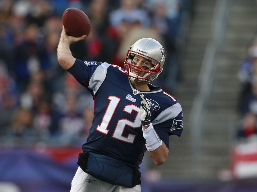 New England Patriots quarterback Tom Brady has thrown for 3,916 yards and 30 touchdowns (and only 10 interceptions) while completing 66.7 percent of his passes this season. (AP Photo/Elise Amendola)